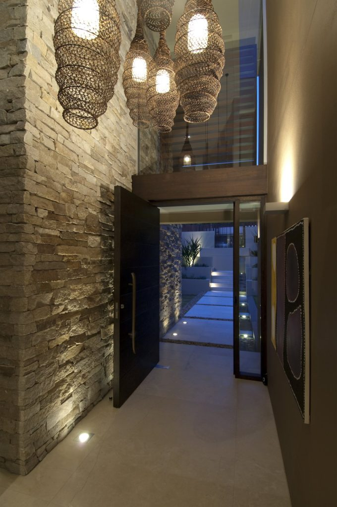 Stone-Wall-and-Cool-Hanging-Lamp-at-Modern-Waterfront-House-Design-by-Bruce-Stafford-Architects